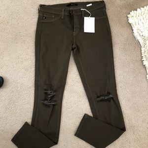 Army green destructed kan can jeans